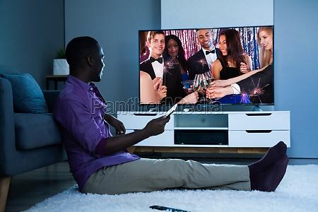 large version of african man watching