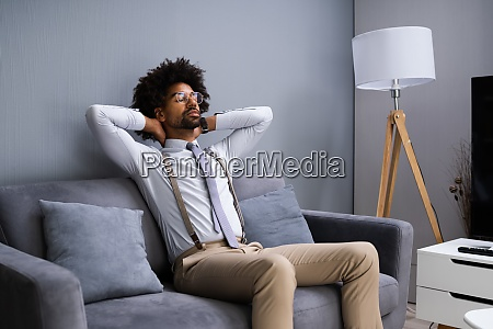 young man sitting on couch relaxing