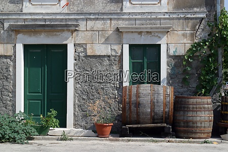barrels in front of house
