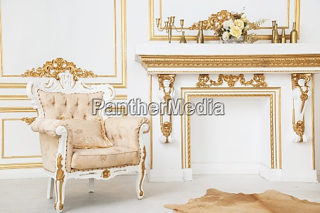 armchair in royal style chimney room