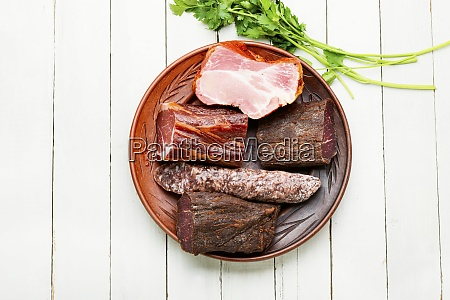 chopping board of cured meat
