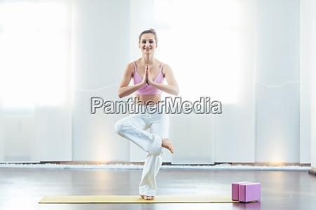 beautiful yoga instructor in her studio