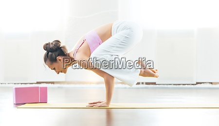 fit yoga instructor in her gym