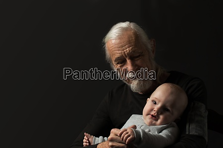 attractive old man posing with little