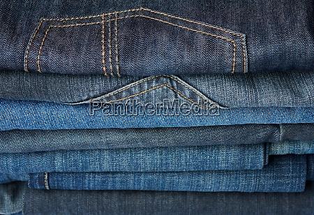 stack of folded blue jeans pants