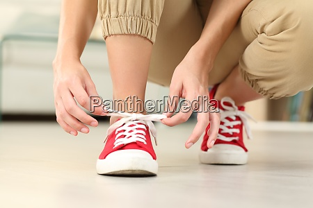front view of woman tying shoelaces