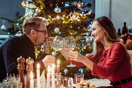 middle aged couple drinking wine on