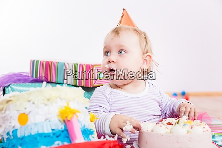 toddler eating birthday cake
