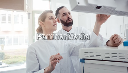 two doctors looking at a screen