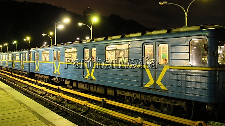 electric train leaving station in subway