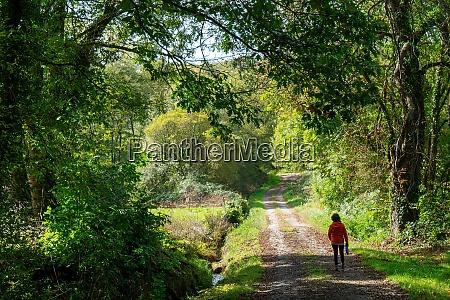 woman walking in countryside
