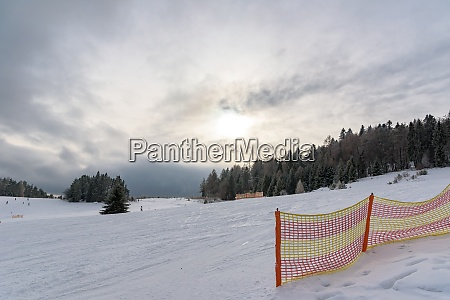 dark clouds over ski slope in