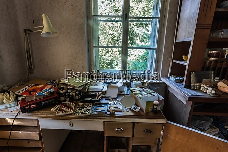 writing desk with many things from