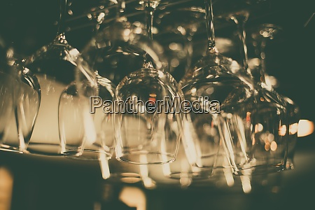 empty wine glasses suspended in a