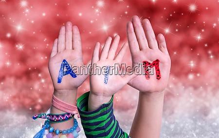 children hands building word aim red