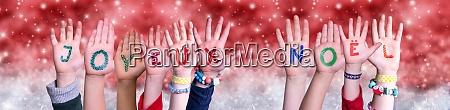 children hands joyeux noel means merry