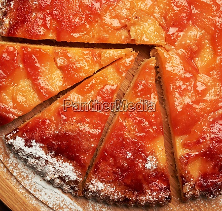 baked round apple pie on wooden