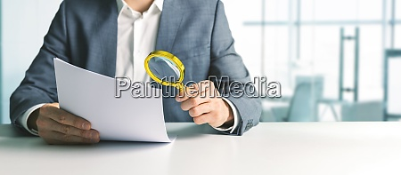 businessman or tax inspector analyzing document
