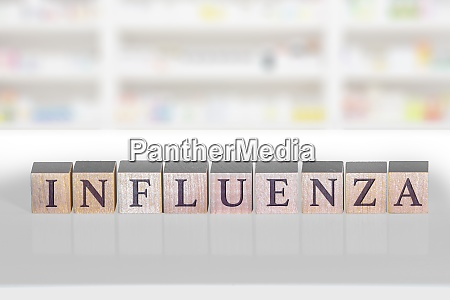 wooden block with the word influenza
