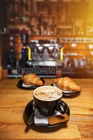 delicious coffee with croissant