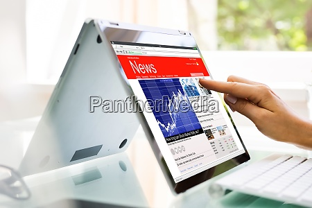 reading news website or electronic newspaper