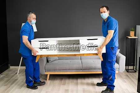professional movers moving tv console furniture