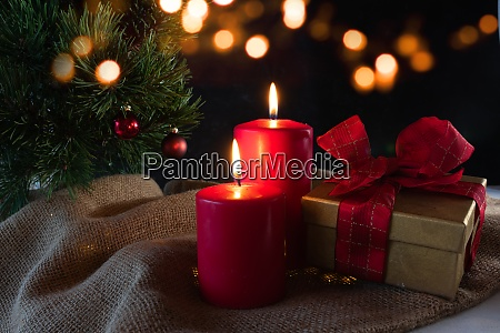 advent candles with christmas ornaments