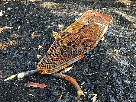 burnt and rusty ironing board after