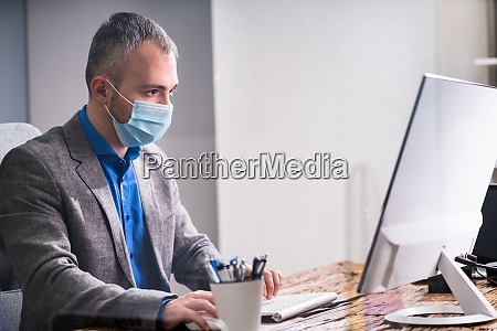 business employees in office wearing medical