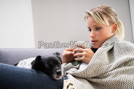 sick woman sitting at home with