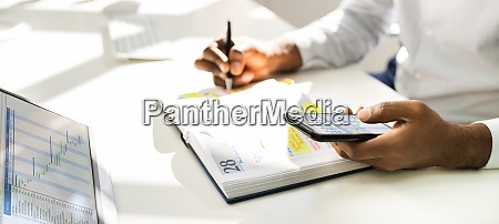 african man organizing appointment schedule using