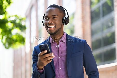 african american man listening music on