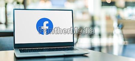 laptop computer displaying logo of facebook