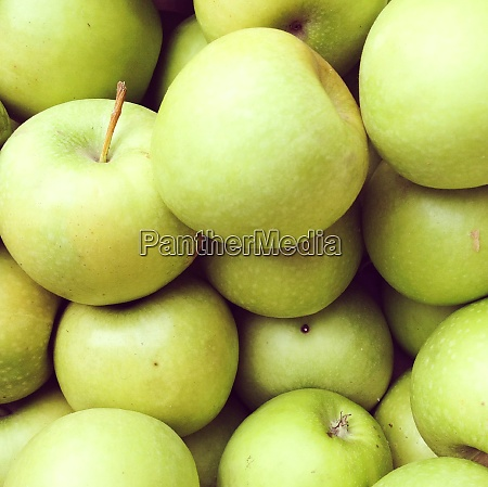 large quantity of green apples