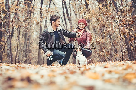 couple in fall having walk with