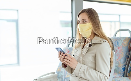 woman using phone in the bus