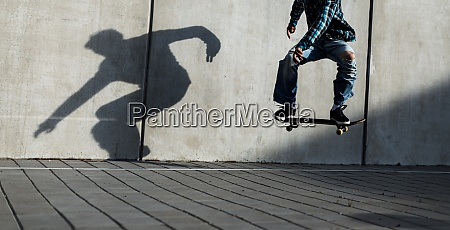 skateboarder riding fast towards the ramps