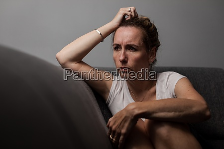 depressed mid aged woman at home