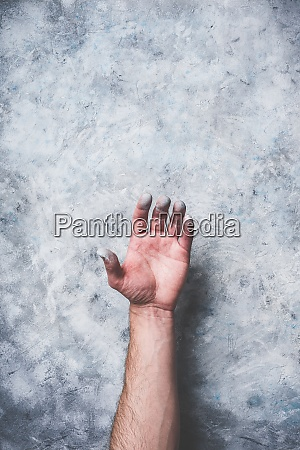 man hand covered with paint