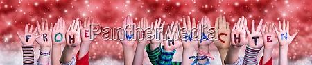 children hands frohe weihnachten means merry