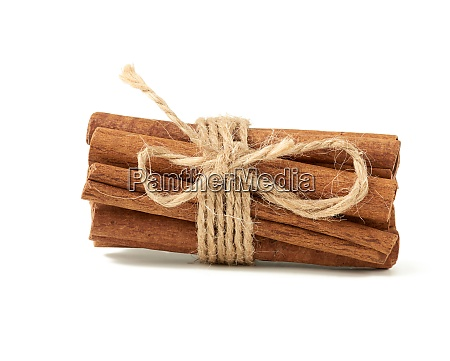 dry cinnamon sticks tied with brown