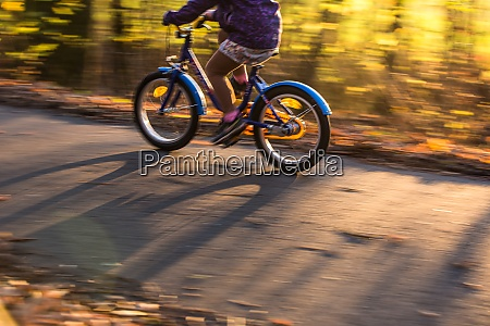 little boy going fast on his