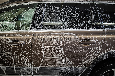 car in a carwash covered with