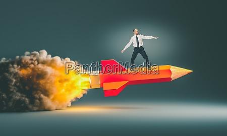 man riding a rocket pencil
