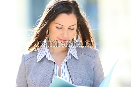 satisfied entrepreneur reading report in the
