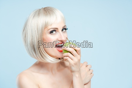 beautiful woman eating green apple for