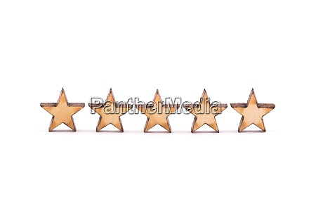 five wooden stars on white background