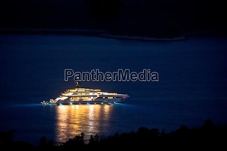 illuminated superyacht on the sea night