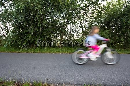 little girl riding her little bike