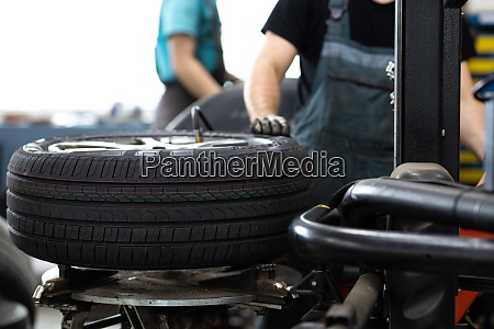 car mechanic changind tires of a
